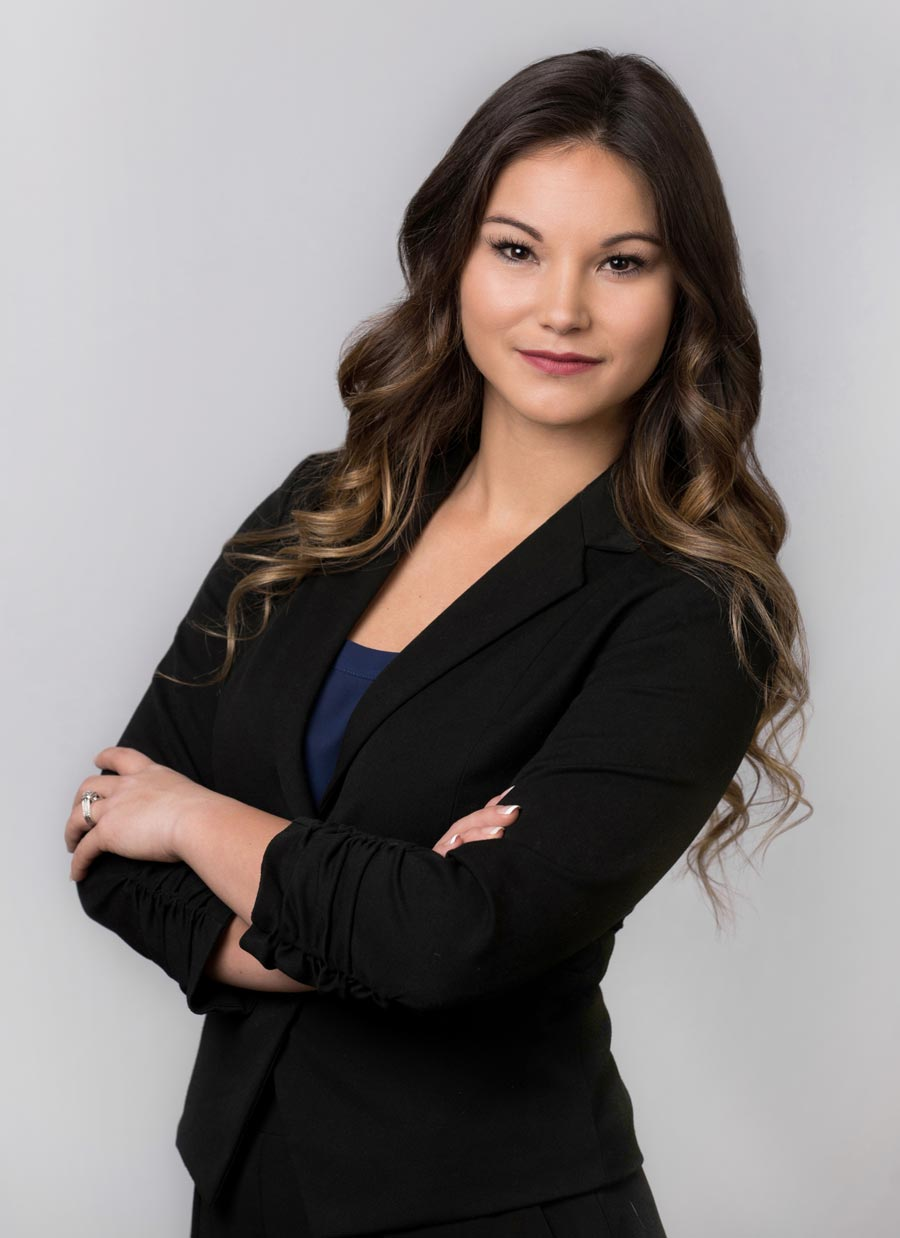 Professional business portrait of a woman using studio lights.