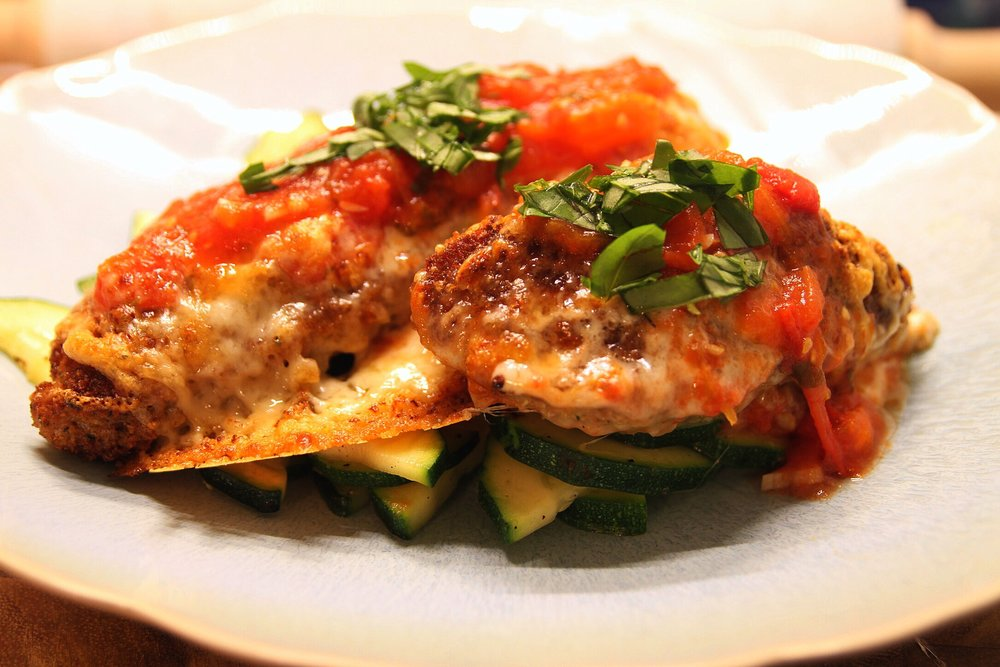A personal favorite: chicken Parmesan with fresh tomato sauce over zucchini. Yum!