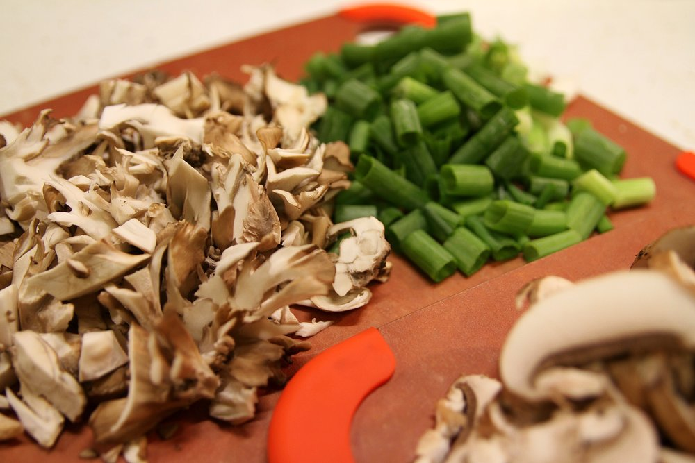 Mushrooms and green onion, waiting.