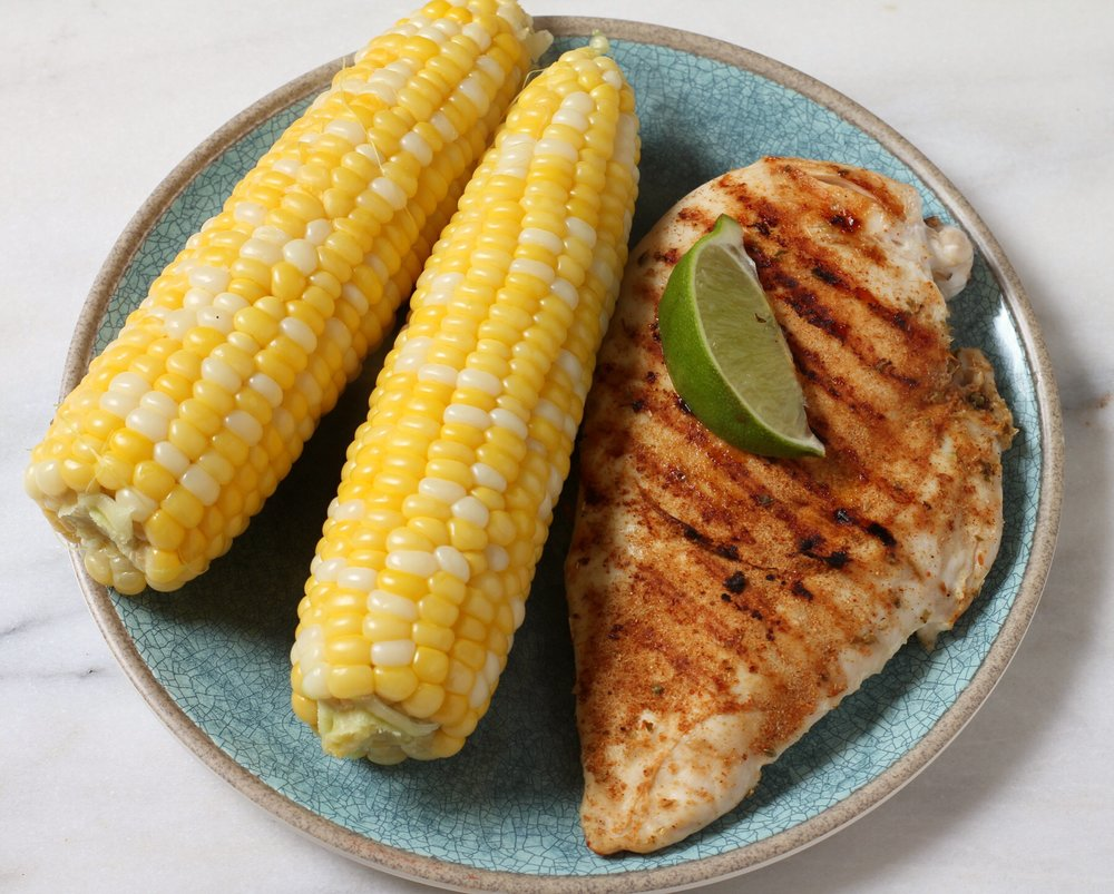Corn on the cob and pan-grilled chicken. Lime wedge just for fun.