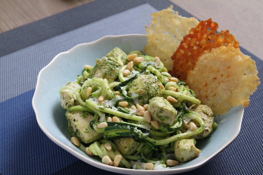 Zucchini noodles with chicken and homemade pesto, and Parmesan crisps.