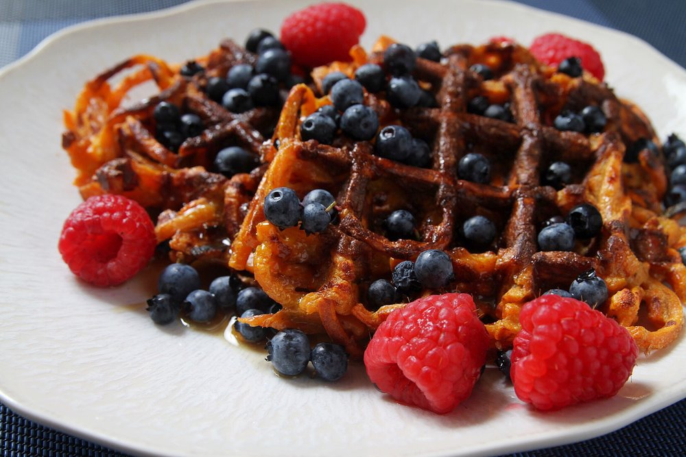 Spiralized sweet potato waffles with pure maple syrup, Maine blueberries, and raspberries.