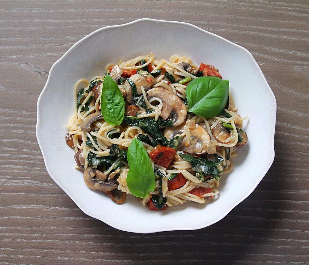 Capellini carbonara with mushrooms and kale.