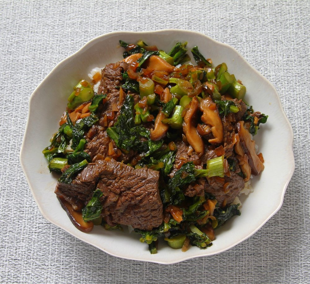 Beef and Chinese broccoli stir fry with shiitake mushrooms and the best sauce ever. Served over jasmine rice.