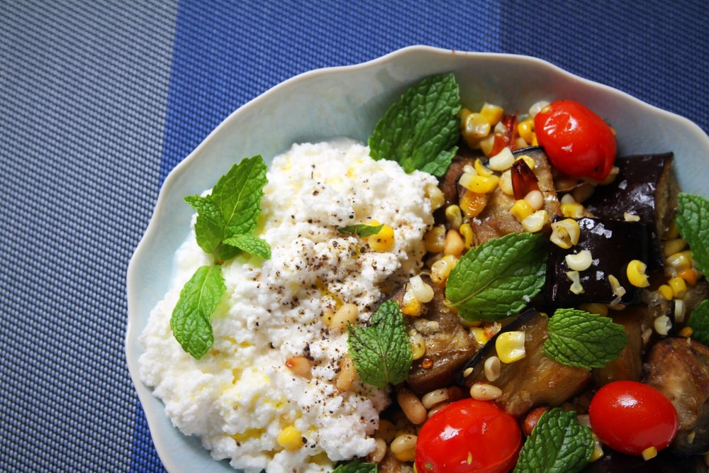 Roasted eggplant and corn with ricotta and mint. And we added tomatoes and pine nuts. Recipe from  Dinner Changing the Game .