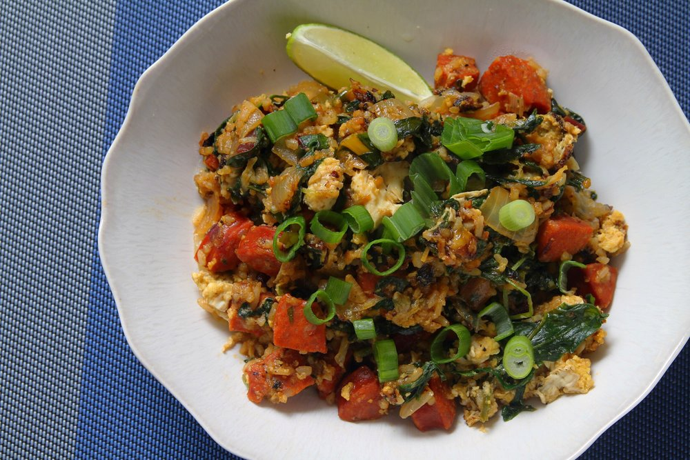 Spicy Thai fried rice with chorizo and greens.
