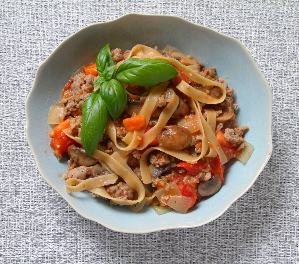 Gluten free tagliatelle with sweet Italian Sausage, mushrooms, tomatoes, onion, and garlic.