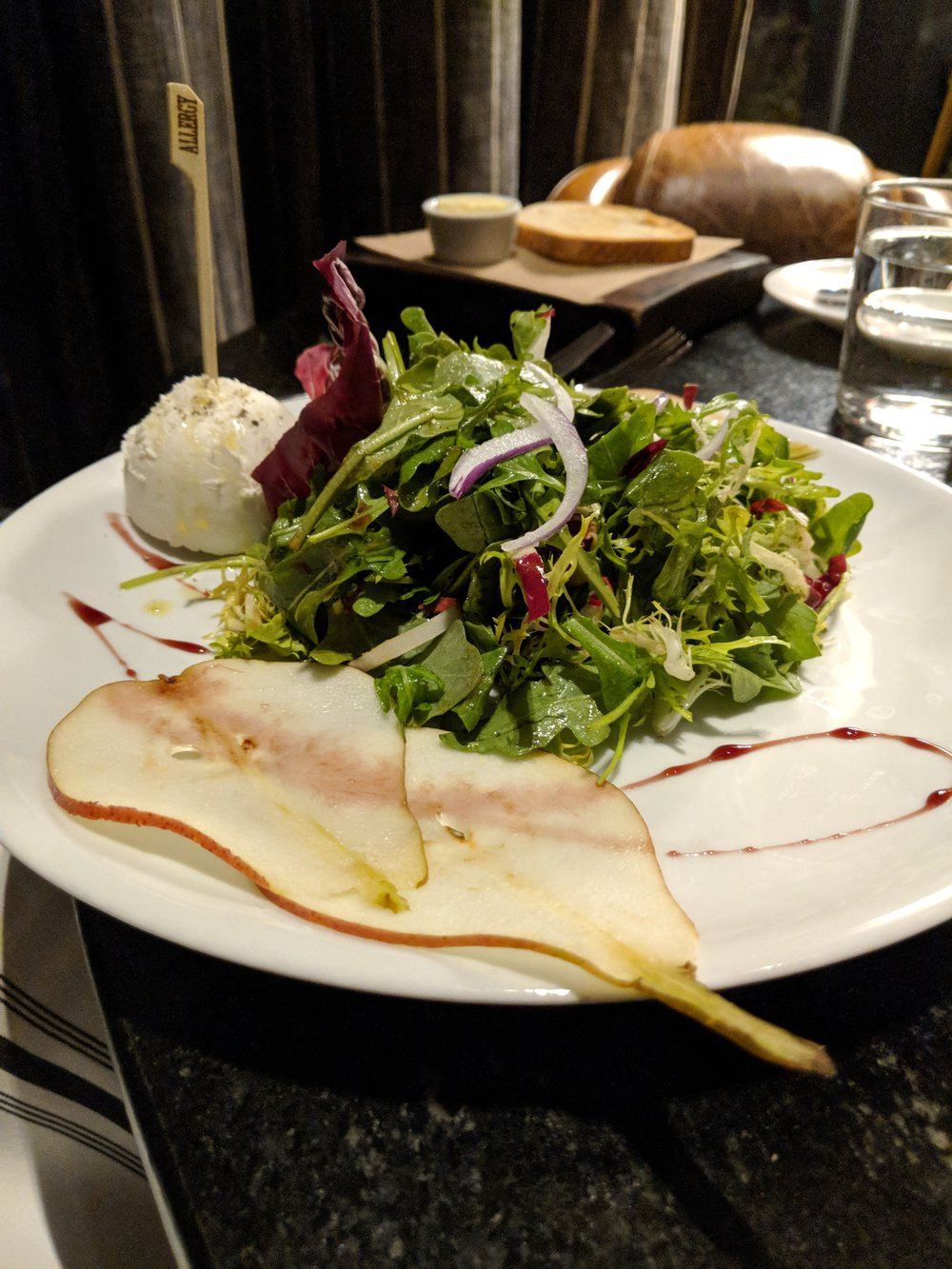 Awesome arugula, goat cheese, and pear salad at The Bancroft. That's an allergy pick in the cheese! ;)