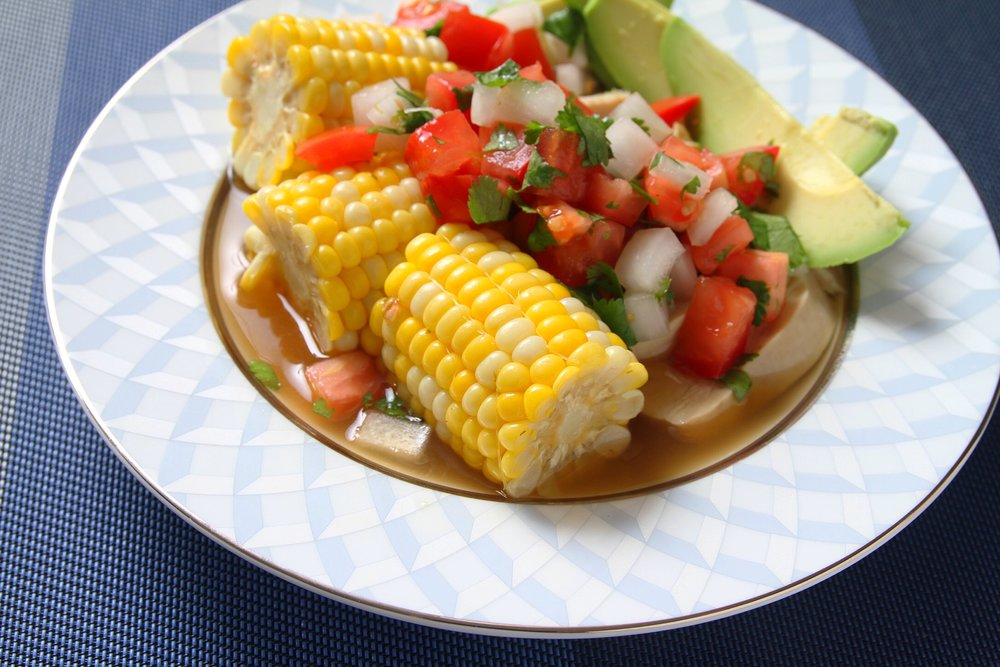 Colombian chicken with corn, salsa, and lime.