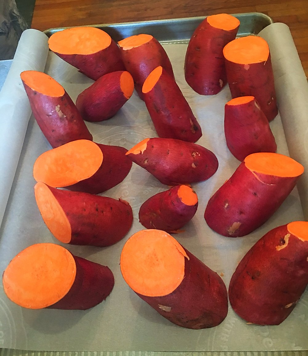 Sweet potatoes as sculpture, before being baked.