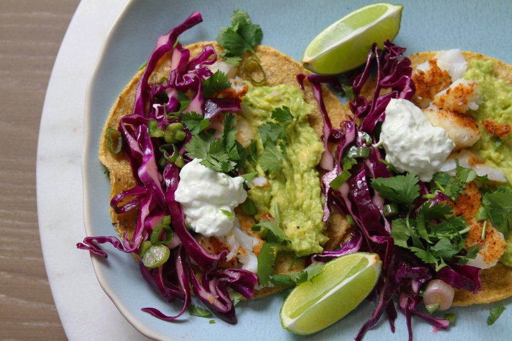 Fish tacos with cabbage slaw,  crema, and avocado.