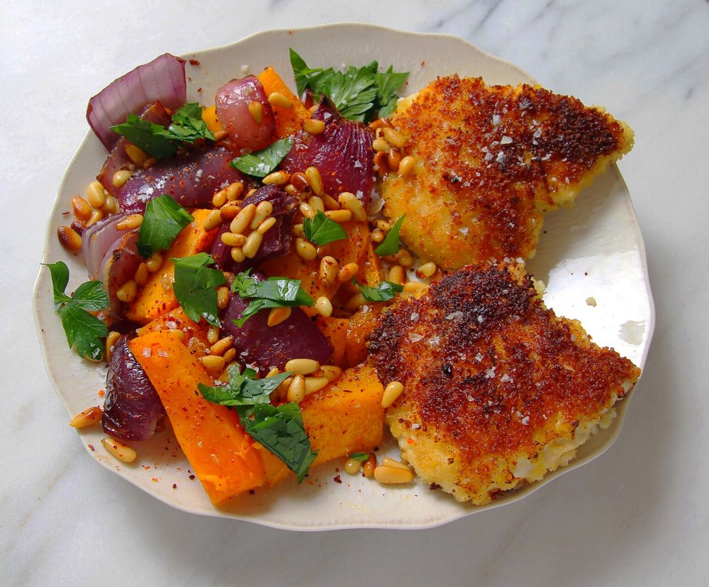 Roasted butternut squash with red onion and warmed pine nuts, parsley, and Aleppo pepper. Paired with Panko-breaded chicken.