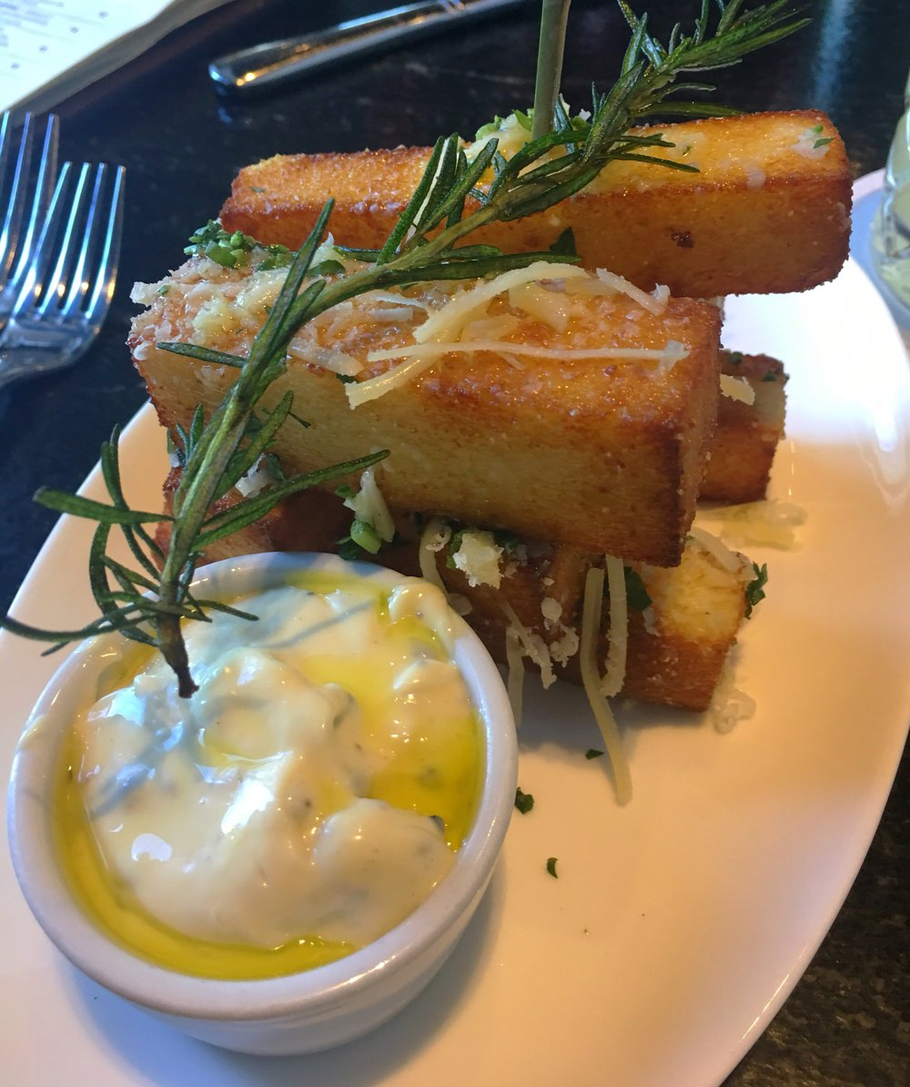 Polenta fries with truffle aioli. An indulgence you shouldn't skip!!