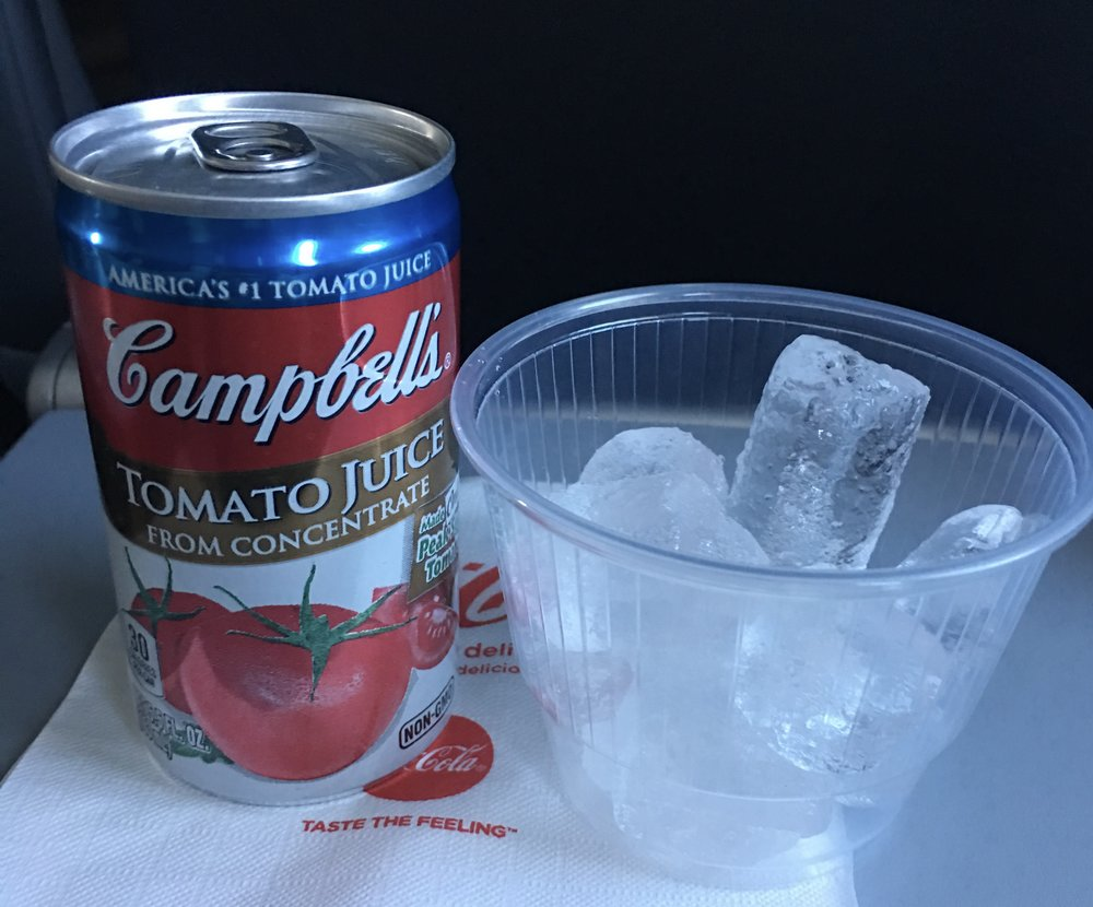 No joke: tomato juice on ice is my in-flight beverage of choice. It makes me weirdly excited to order it and a little giddy while sipping it on the flight.