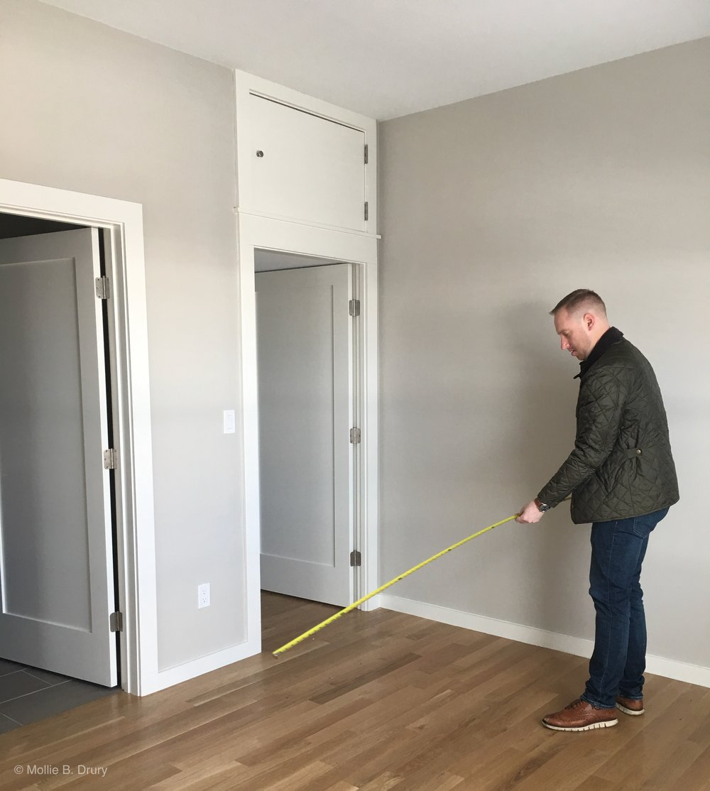 Seth measuring! Have to make sure the furniture will fit. 😬