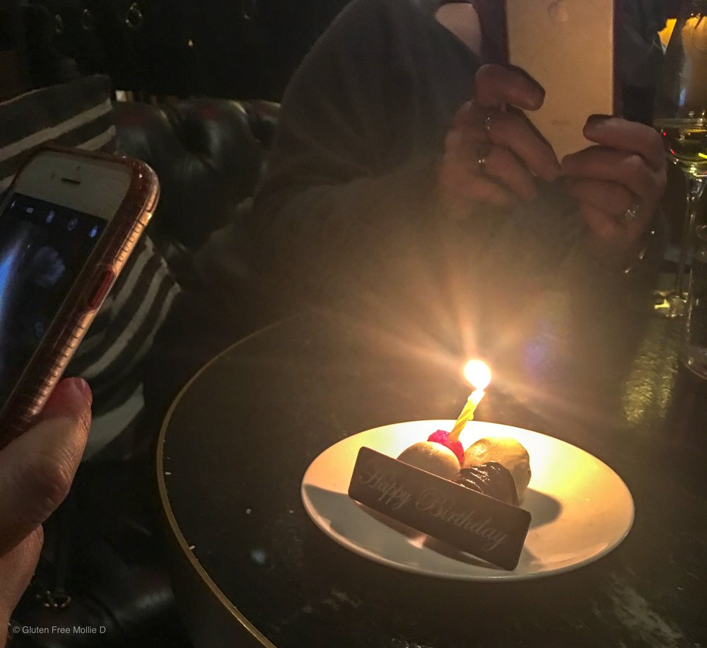 My photo-loving family snapping shots of her birthday dessert! :)