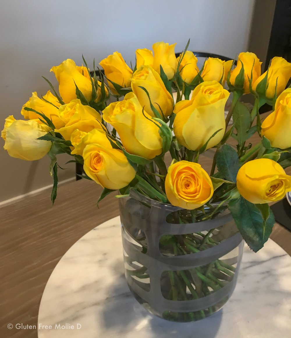 Yellow roses make a fun splash in our apartment.