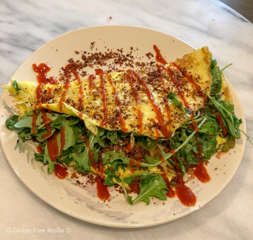 I made this arugula-packed omelette on Saturday morning, post-walk. OMG it was awesome.