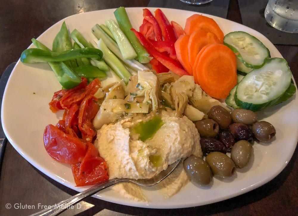 Hummus plate with veggies and goodies.