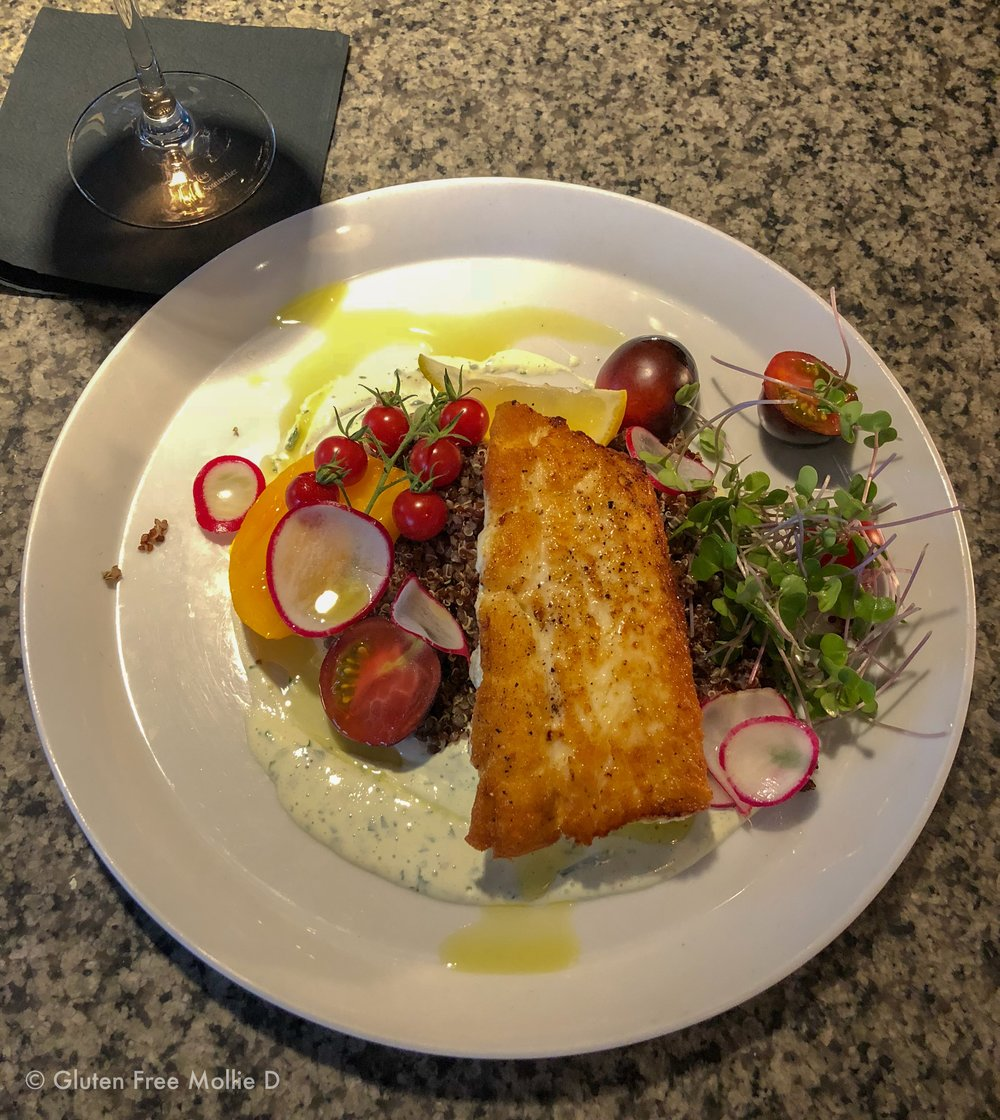 Perfect halibut over quinoa with tomatoes, radishes, and greens.