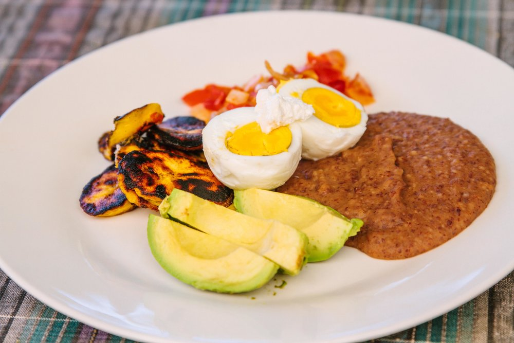 Plate with eggs, beans, avocado, plantains, and red sauce. Delicious breakfasts served at the Discovering Birth Midwifery Retreat at the Bambu Guest House, Lake Atitlan, Guatemala, July 14-27, 2019