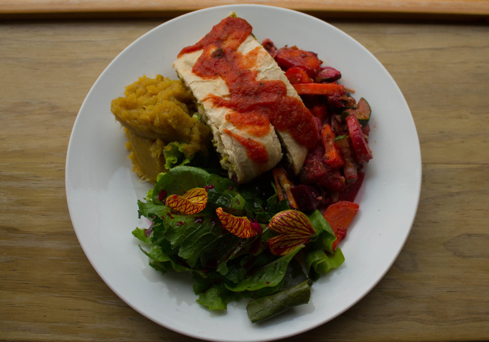 Plate with green salad, sweet potato, sauteed vegetables and a stuffed loaf topped with tomato sauce. Filling and nutritious meals featured at the Discovering Birth Midwifery Retreat this July 14-27, at the Bambu Guest House, Tzununa, Guatemala!