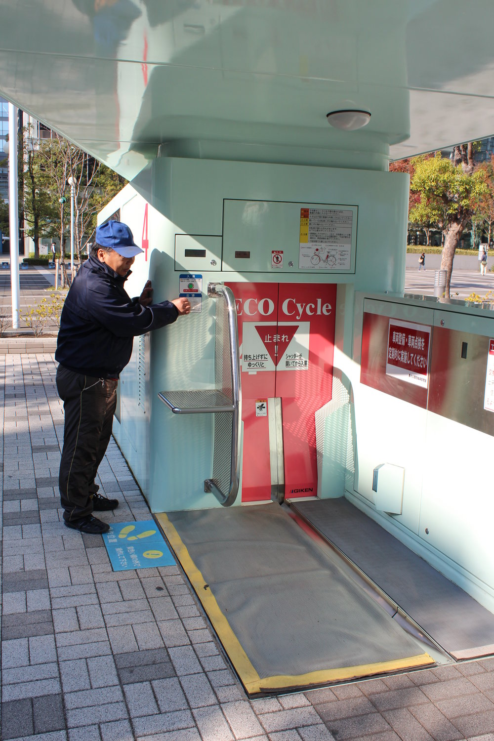 Amazing Tokyo bike parking pulls bike into device and in seconds it's in a secure underground carousel.