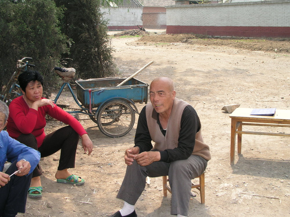 In a village north of Beijing the elders said no outsiders allowed , in hopes of keeping SARS out, even if it hurt their vegetable sales.2.JPG