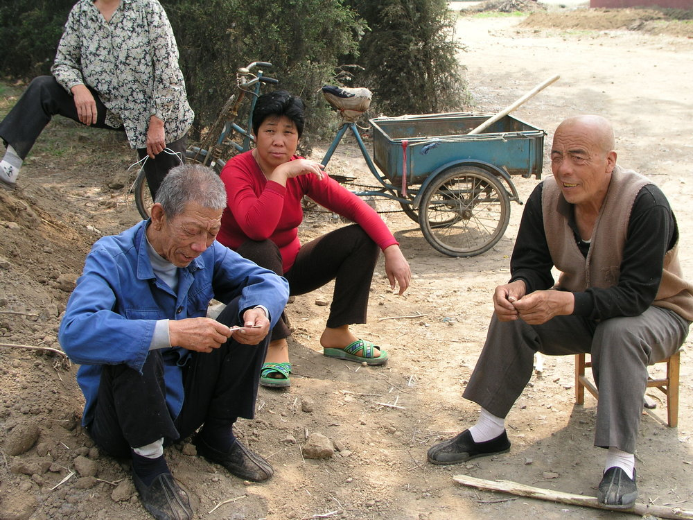 In a village north of Beijing the elders said no outsiders allowed , in hopes of keeping SARS out, even if it hurt their vegetable sales.3.JPG