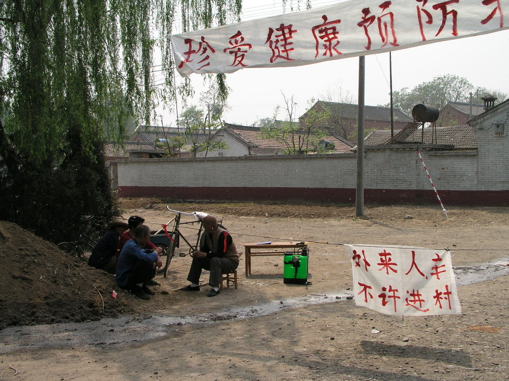 In a village north of Beijing the elders said no outsiders allowed , in hopes of keeping SARS out, even if it hurt their vegetable sales.5.JPG