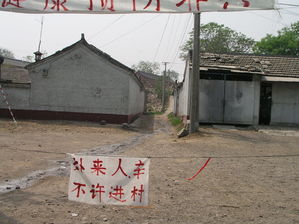 In a village north of Beijing the elders said no outsiders allowed , in hopes of keeping SARS out, even if it hurt their vegetable sales.6.JPG