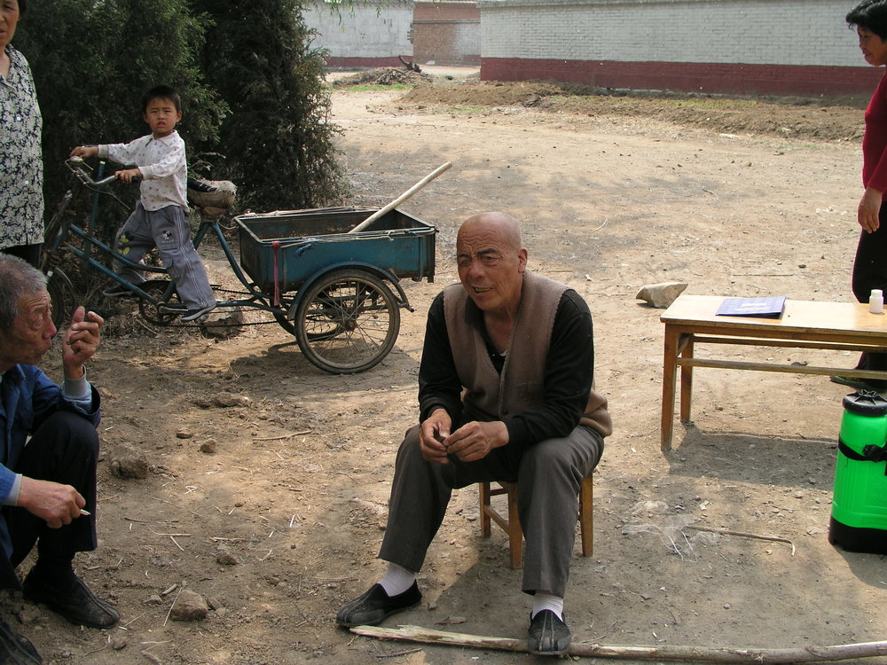 In a village north of Beijing the elders said no outsiders allowed , in hopes of keeping SARS out, even if it hurt their vegetable sales.7.JPG