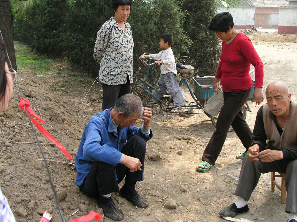 In a village north of Beijing the elders said no outsiders allowed , in hopes of keeping SARS out, even if it hurt their vegetable sales.8.JPG