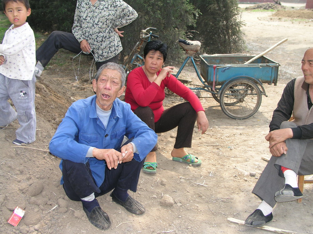 In a village north of Beijing the elders said no outsiders allowed , in hopes of keeping SARS out, even if it hurt their vegetable sales.12.JPG
