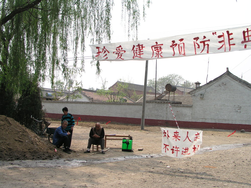 In a village north of Beijing the elders said no outsiders allowed , in hopes of keeping SARS out, even if it hurt their vegetable sales.13.JPG