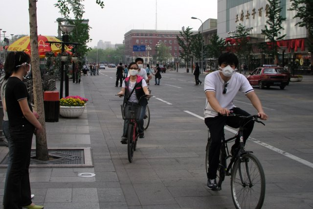 Late April in Beijing, where even outdoors people wore masks against SARS .jpg