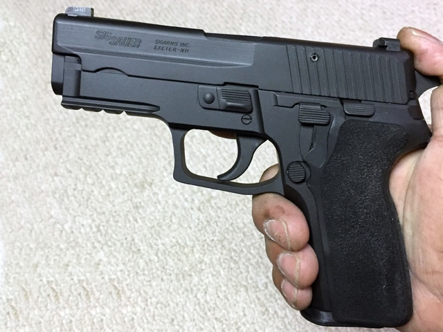 """The slide and frame are Cerakoted with Graphite black, all the other components are coated in Armor black. I added an SRT kit and with a little modifying I was able to fit a P229-E2 grip onto the frame perfectly. """
