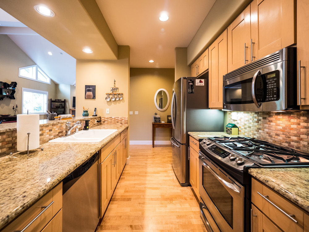 Gourmet kitchen with stainless steel appliances and solid granite countertops.