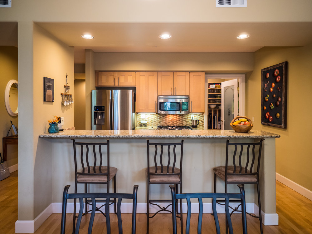 Open kitchen features spacious eating bar.