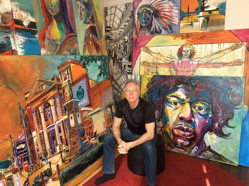Me and my paintings.jpg