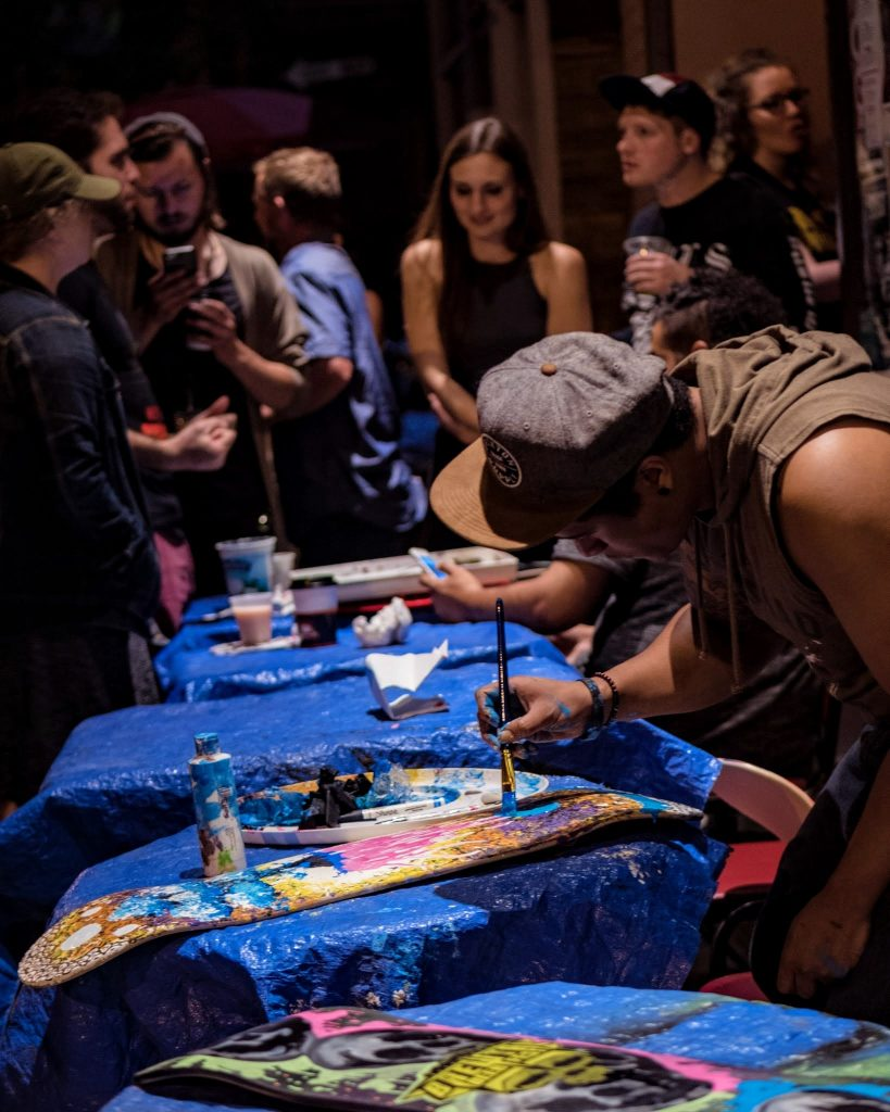 Oliver Moss painting a Brewtal Skate Deck at our Brews & Brushes Pre-Party event this past weekend. Photo taken by Ryan Haggerty.