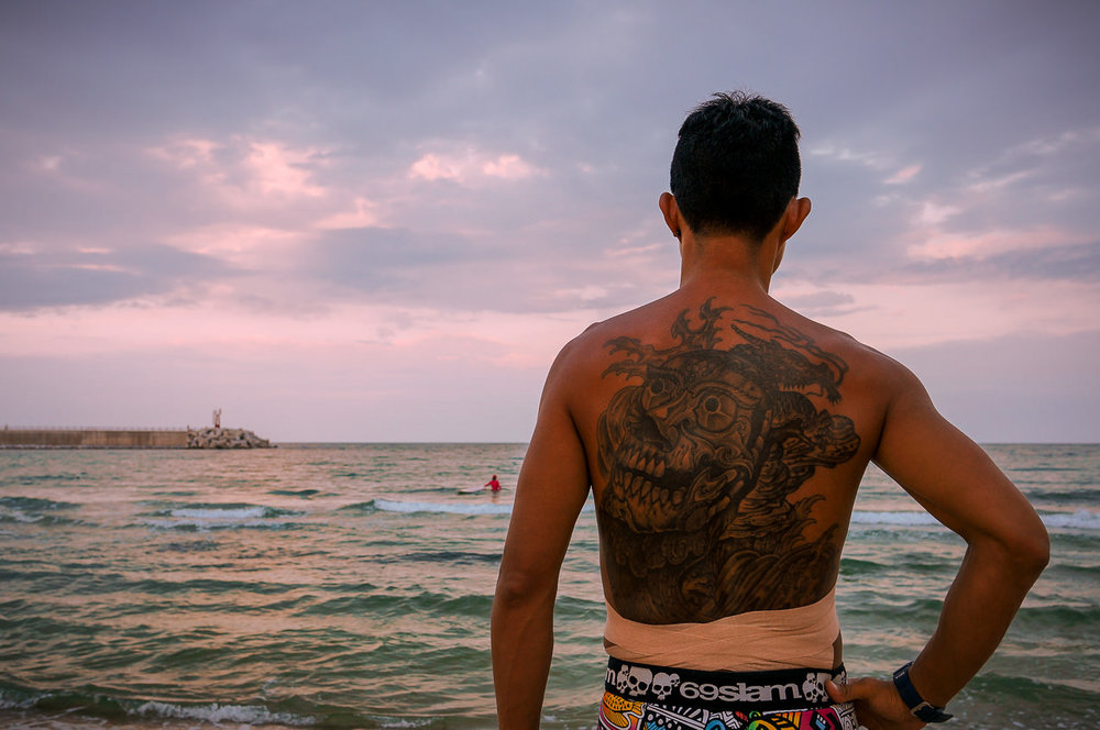 Gentle surf and quiet, placid stretches of coastline marked much of my journey north. As I moved closer to North Korea, though, the beaches were increasingly marred by decaying cinder-block pillboxes & rusting, barbed wire-entwined fences.