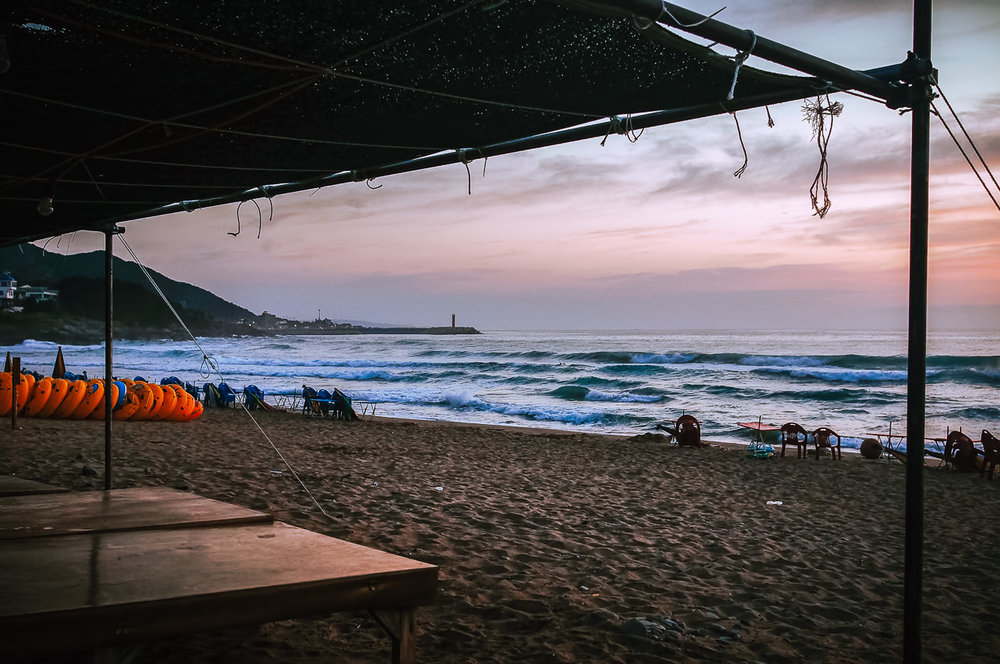 Koreans are fond of these awnings - they like to dine right there on the sand - & those inflatable rings you can see on the left.