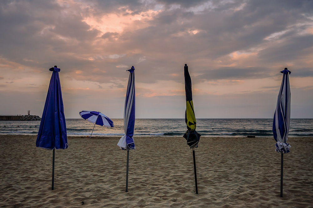 Beach umbrella sentinels. This was the same night & beach as the tattooed-surfer shot from the last post.