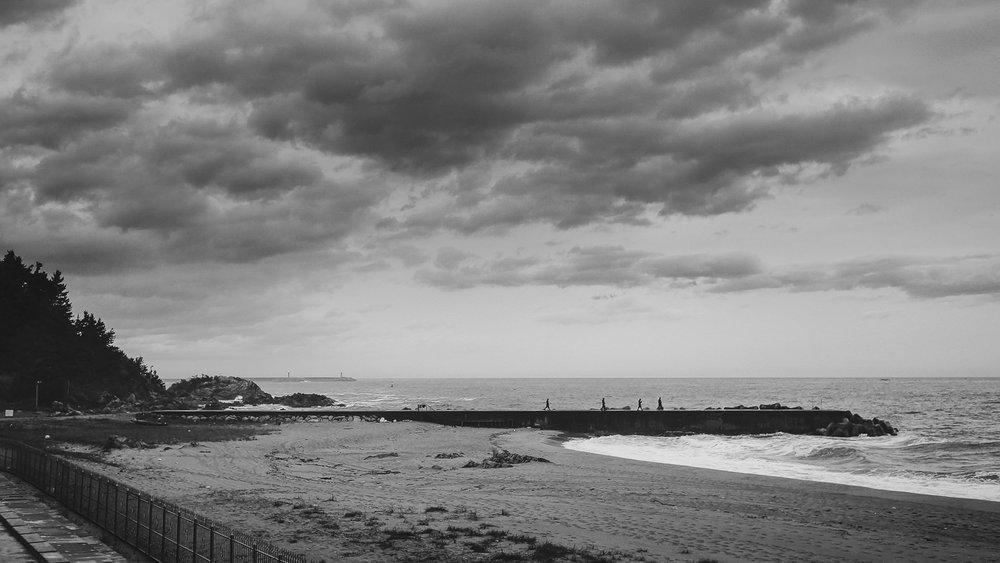 My final morning, nearing Sokcho. Soldiers patrol the beach beneath an ominous sky.