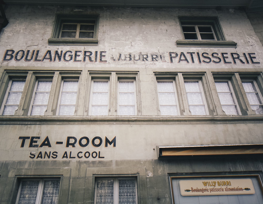 A bakery facade in the French part of Fribourg, the most beautiful city I explored in Switzerland.