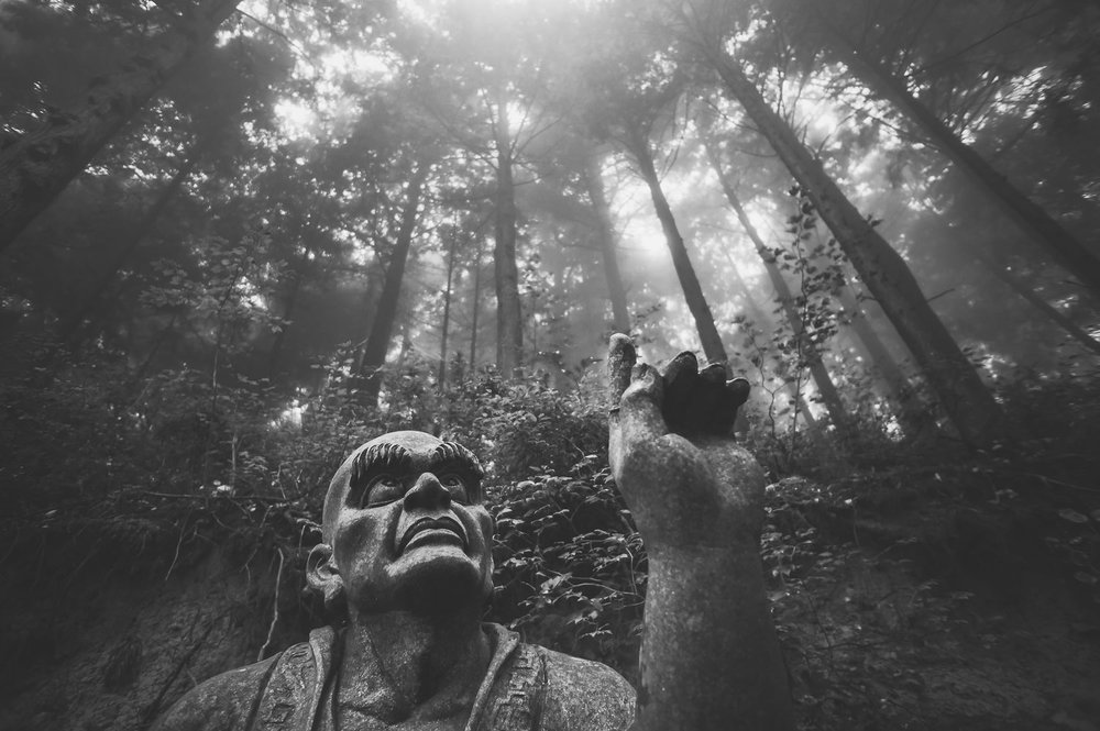 """A Rakan (an enlightened being) points to the heavens on a mountaintop near Unpen-ji (""""Hovering Clouds Temple""""), Kagawa, 2015."""
