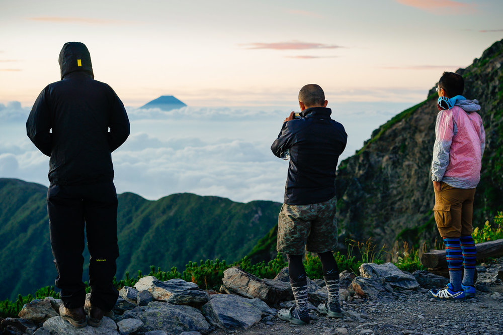 Dawn on the approach to the summit of Kita-Dake (3,193m), Japan's 2nd-highest peak. Hikers enjoy the emergence from its cloak of cloud of Fuji-San (3,776m), highest mountain in the country. This was my 2nd time doing this hike in the South Alps, 14 years or so after my first.