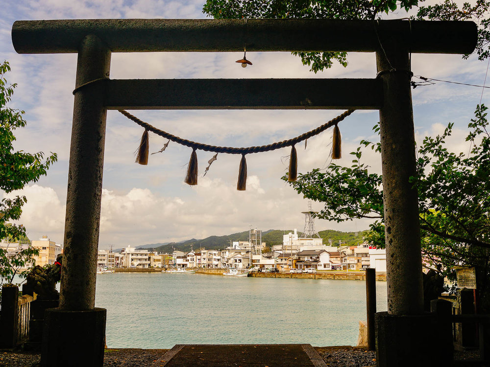 View through a shrine gate in the fishing town of Tosashimizu, Kochi. Both on this occasion (2015) & this year I camped in a park nearby.