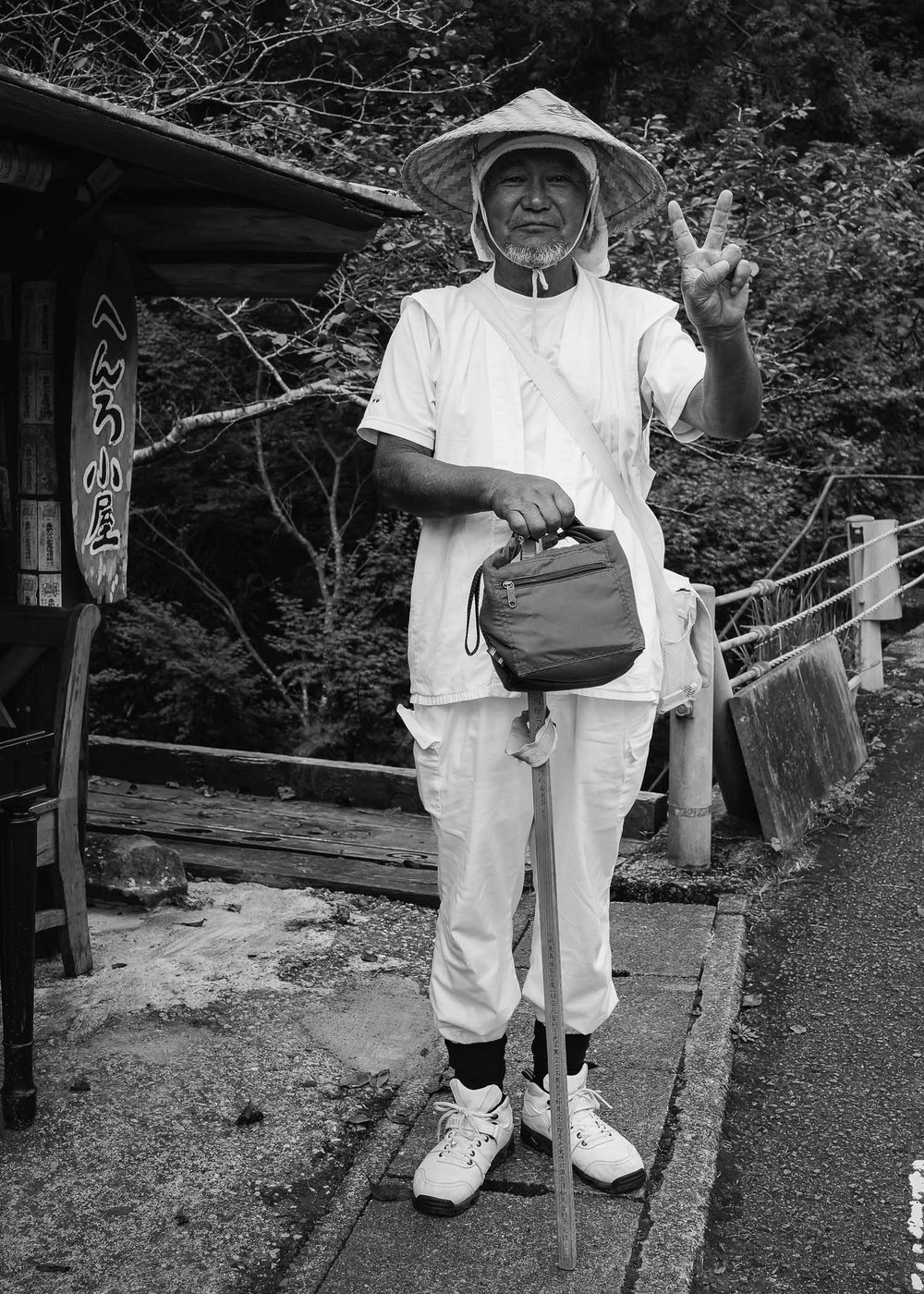 2015: A kind Henro smiles for a portrait at a roadside shelter on Cape Ashizuri where I'd spent the previous night. This year I made it there in the morning after getting lost the (rainy) night before & having to crawl under the eaves of a village shrine to attempt sleep.